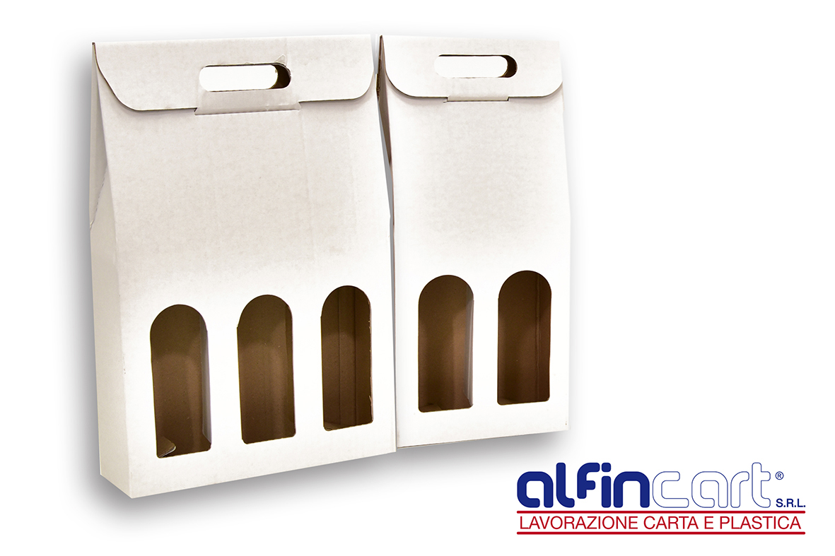 Wine Bottle Carriers manufactured from white recyclable cardboard.