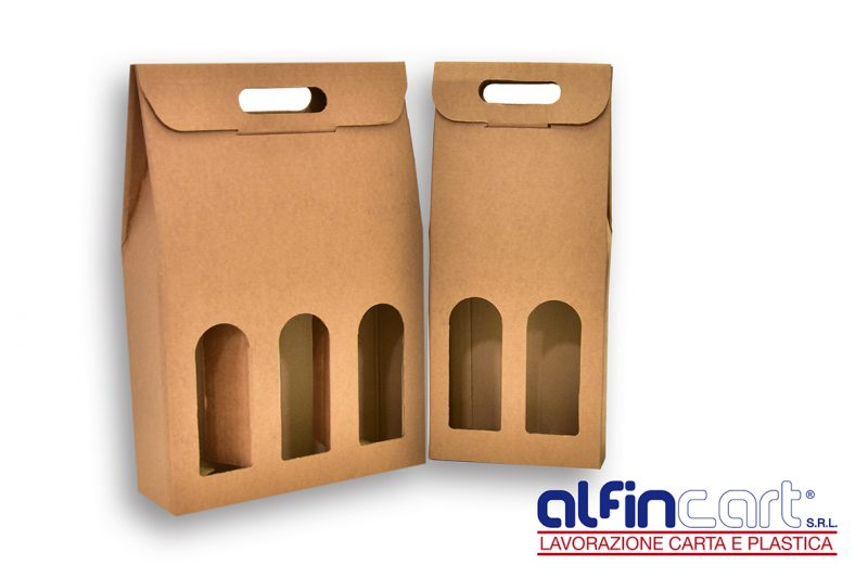 Wine Bottle Carriers manufactured from brown recyclable cardboard.